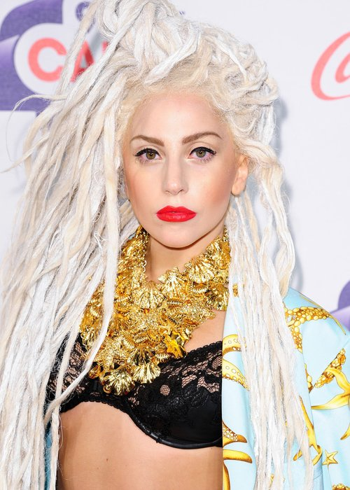 Lady Gaga arriving for the Jingle Bell Ball in a black bra suit and blonde dreadlocks
