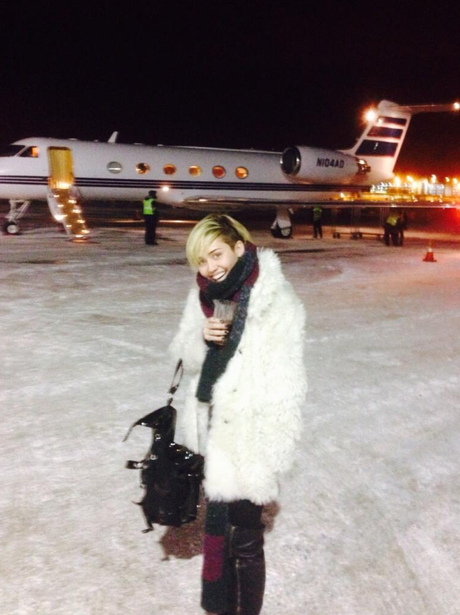 Miley Cyrus boards a private jet