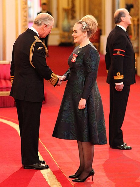 Adele with Prince Charles at Buckingham Palace