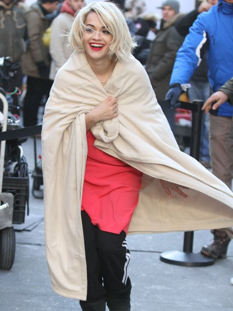 Rita Ora plays on a DKNY photo shoot in New York.
