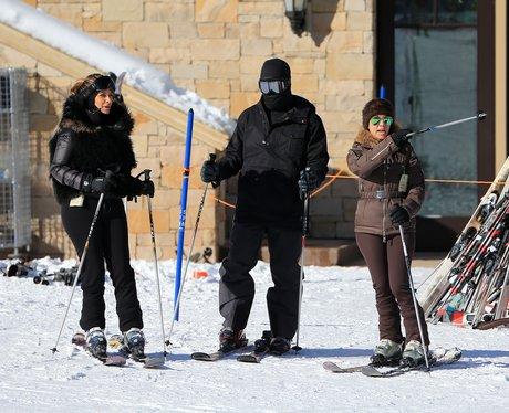 Kanye West and Kim Kasdashian skiing