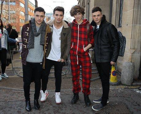 Union J in London with Josh wearing a onesie