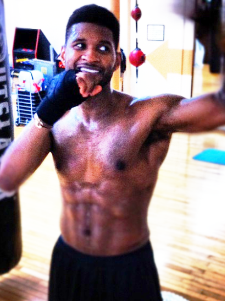 Usher practices his boxing moves in the gym
