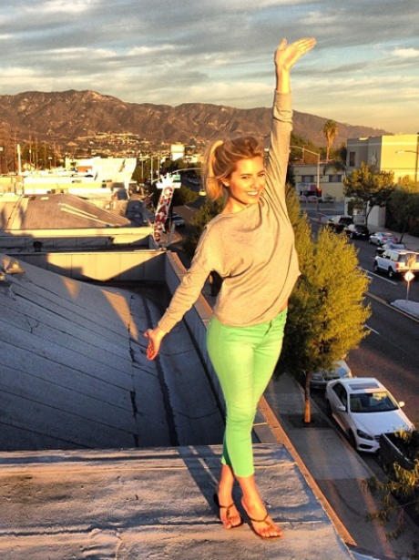 Mollie King standing on a roof