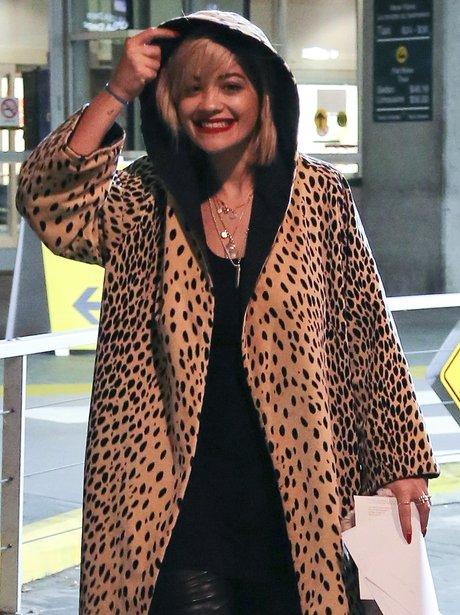 Rita Ora wearing a leapoard print coat
