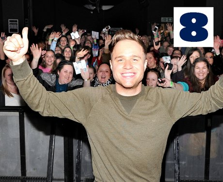 Olly Murs poses with some of his fans