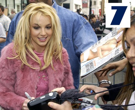 Britney Spears poses with some of her fans