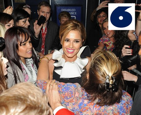 Cheryl Cole poses with some of her fans