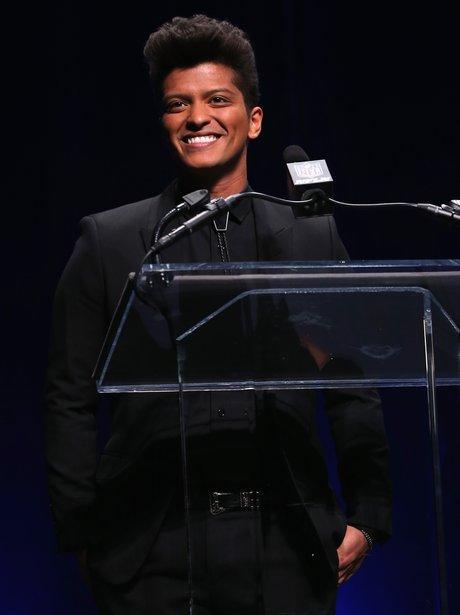 Bruno Mars speaking on stage