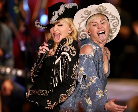 Miley Cyrus and Madonna on stage