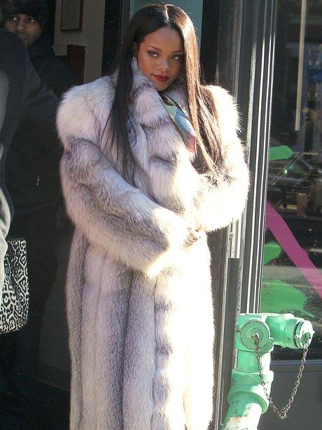 Rihanna wearing a fur coat