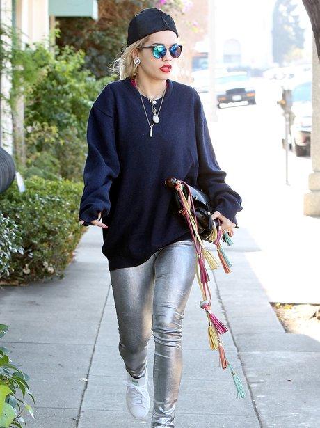 Rita Ora wearing silver leggings