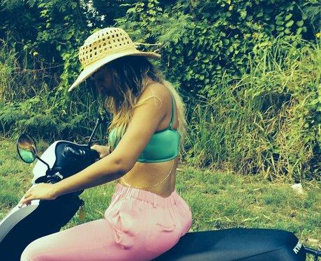 beyonce wearing a bikini on a bike