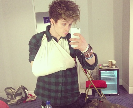 Conor from The Vamps with a sling