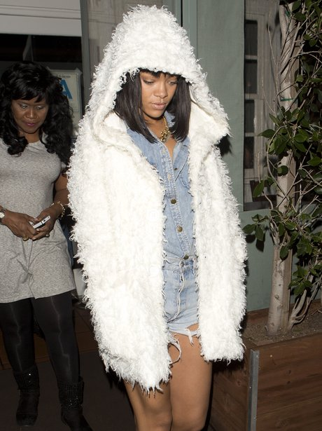 Rihanna wearing a white fur jacket