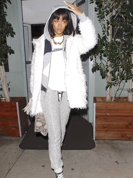 Rihanna wearing a white tracksuit