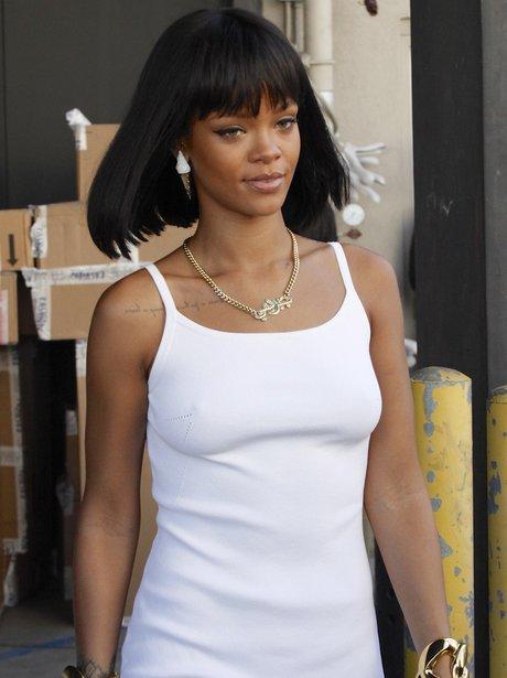 Rihanna wearing a tight white dress