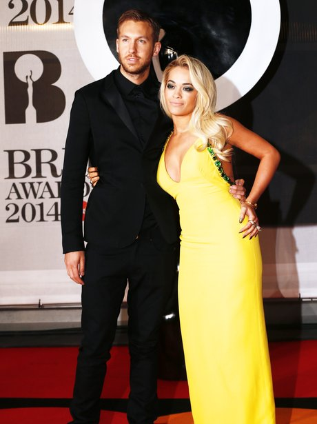 Rita Ora and Calvin Harris walk the BRIT Awards 2014 red carpet