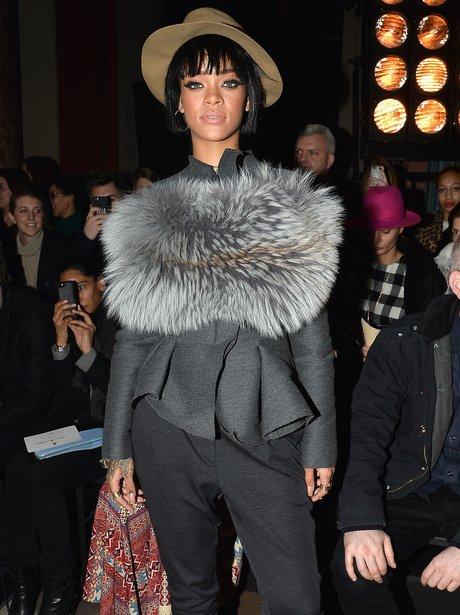 Rihanna attends a Paris Fashion Week show