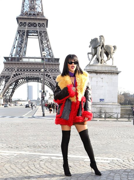 Rihanna poses by the Eiffel Tower