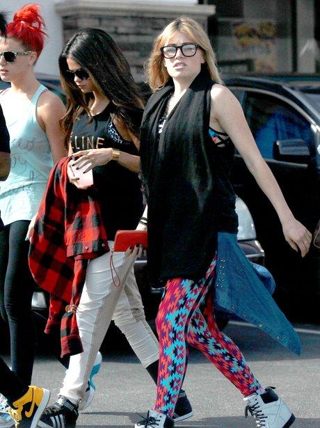 Selena Gomez wearing glasses