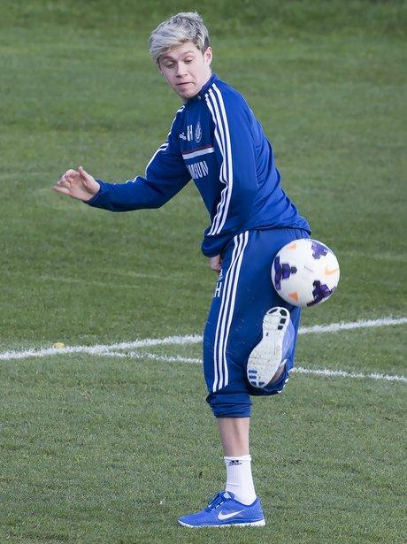 Niall Horan playing football