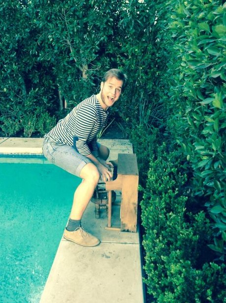olly murs with miniature piano by the pool