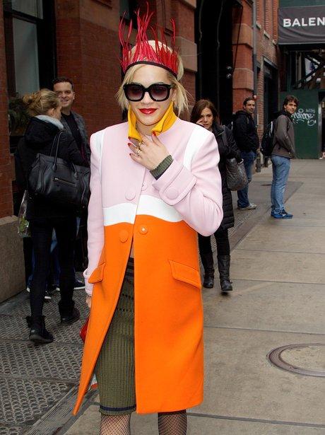 Rita Ora wearing a head dress