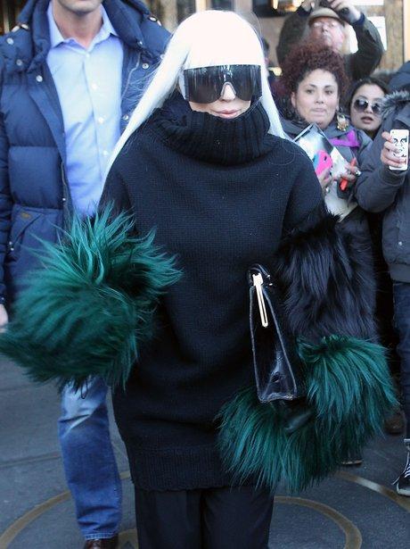 Lady Gaga wearing green gloves