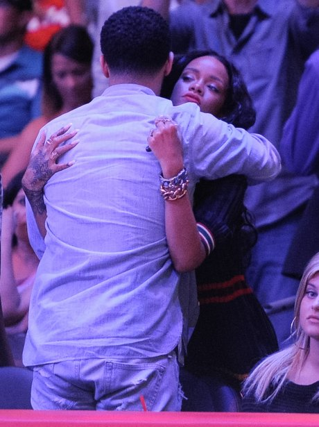 Rihanna and Drake hug at the beasketball