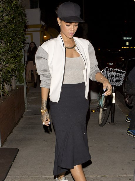 Rihanna wearing trainers out for dinner