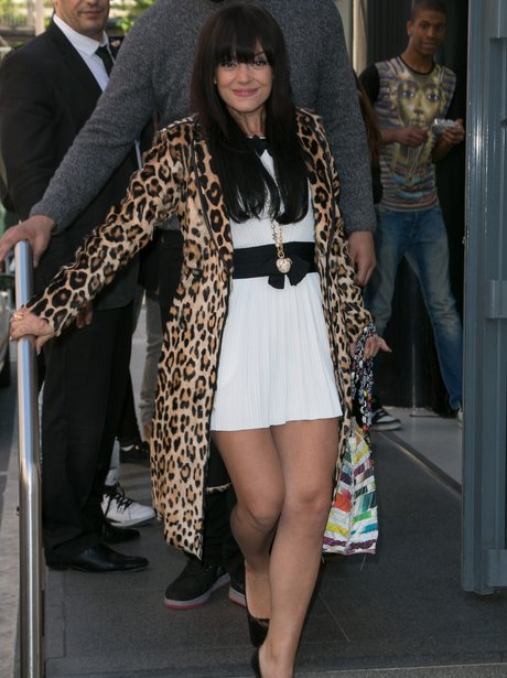 Lily Allen wears a leopard print coat in Paris