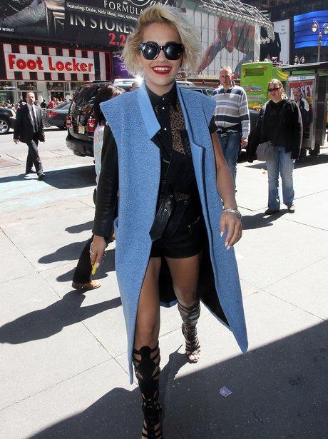 Rita Ora wears leather shorts and sunglasses