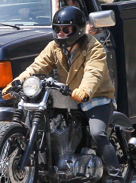 Harry Styles on a motorbike