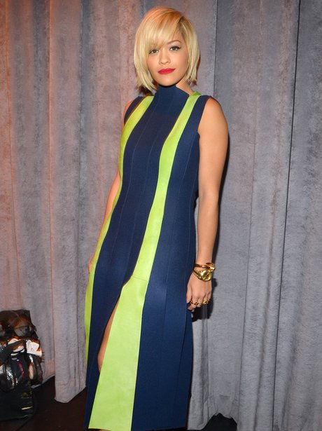 Rita Ora wearing a stripey dress