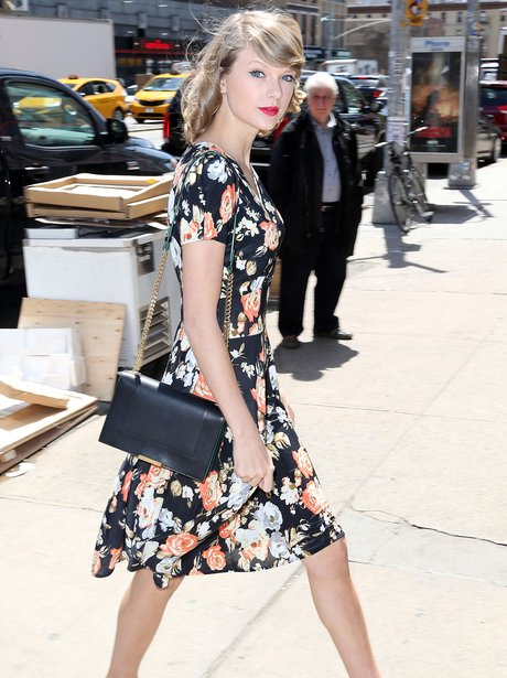 Taylor Swift wearing a floral dress