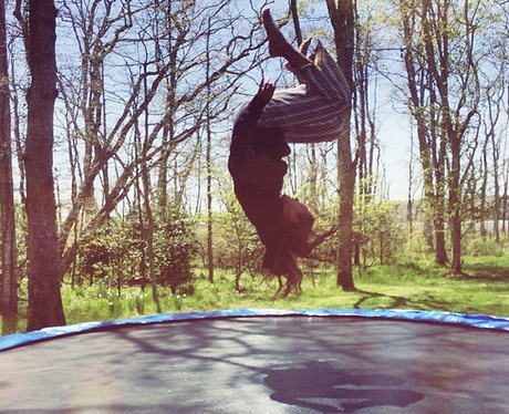 Beyonce bounces on a trampoline