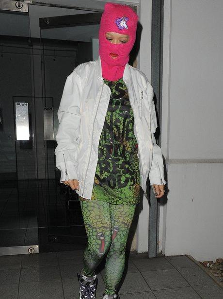 Rita Ora  wearing a pink balaclava