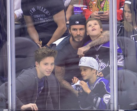 David Beckham and Kids watch a hockey game