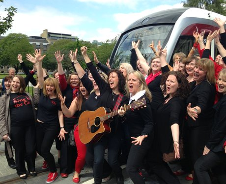 Flashmob choir Sing In The City at the tram launch