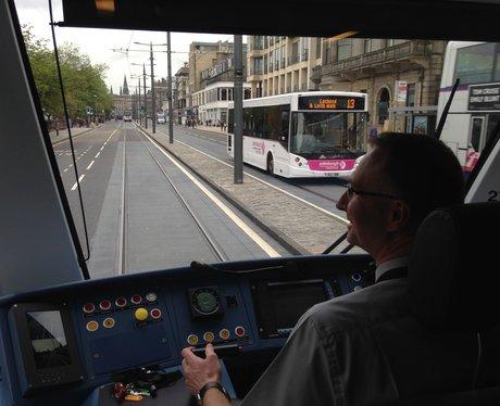 A tram travels along Edinburgh's Princes Street