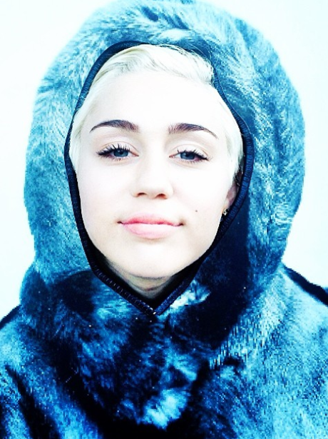 Miley Cyrus wearing a fur hood