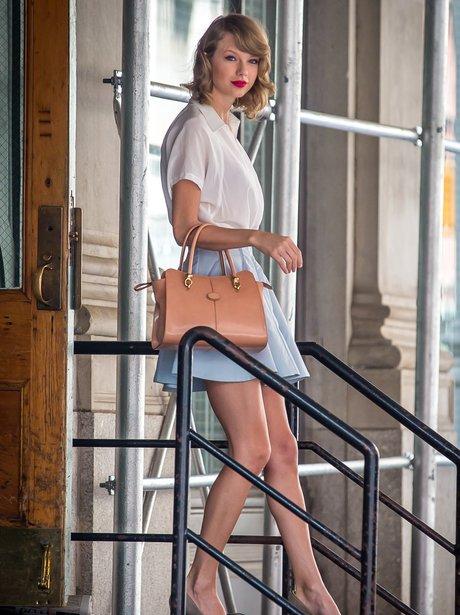 Taylor Swift wearing mini skirt