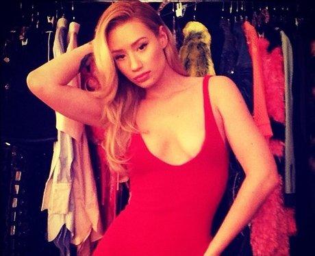 Iggy Azalea wearing a red dress