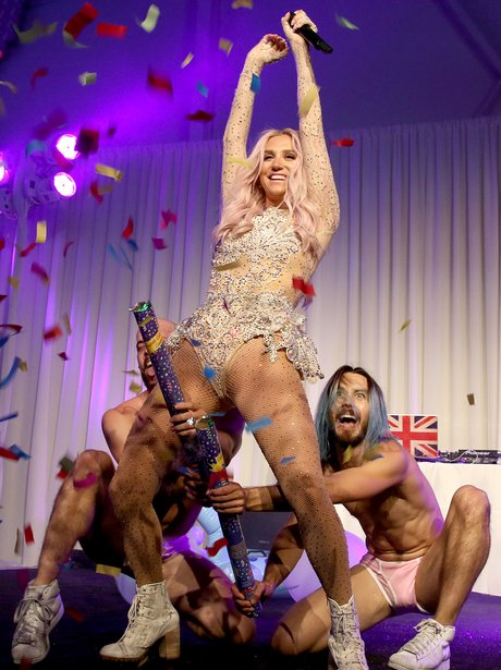 Kesha performing at a charity event