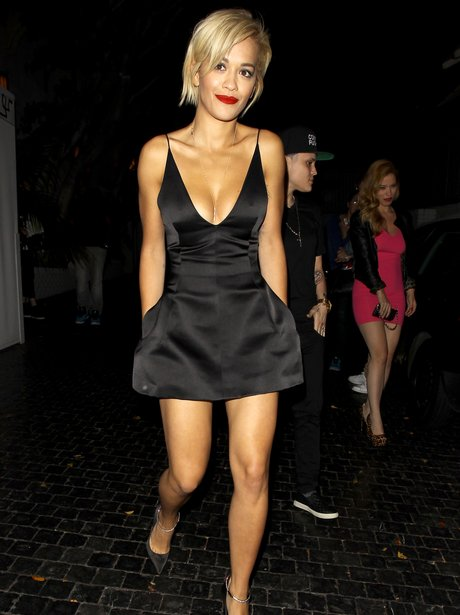 Rita Ora wearing a black dress on a night out