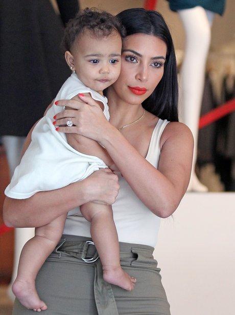 Kim Kardashian and Baby North with diamond earring