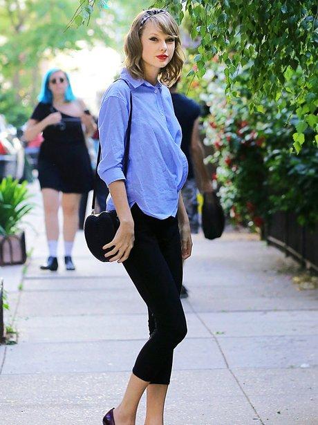Taylor Swift wearing a head band