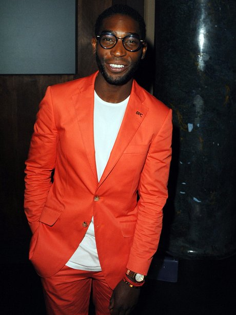 Tinie Tempah wearing a orange suit