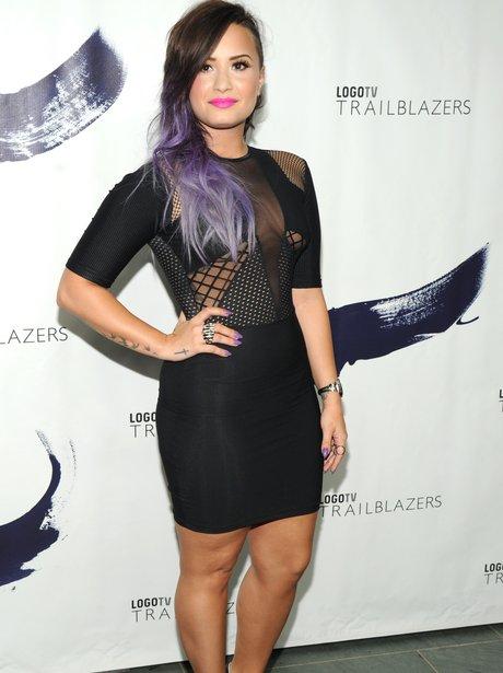 Demi Lovato wearing a tight black dress